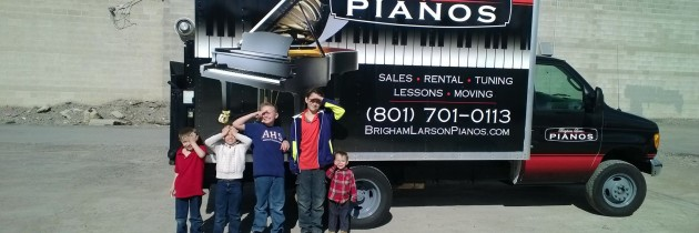 The Larson brothers, helping Dad move pianos